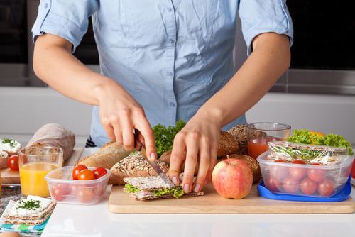 shutterstock_woman preparing lunch